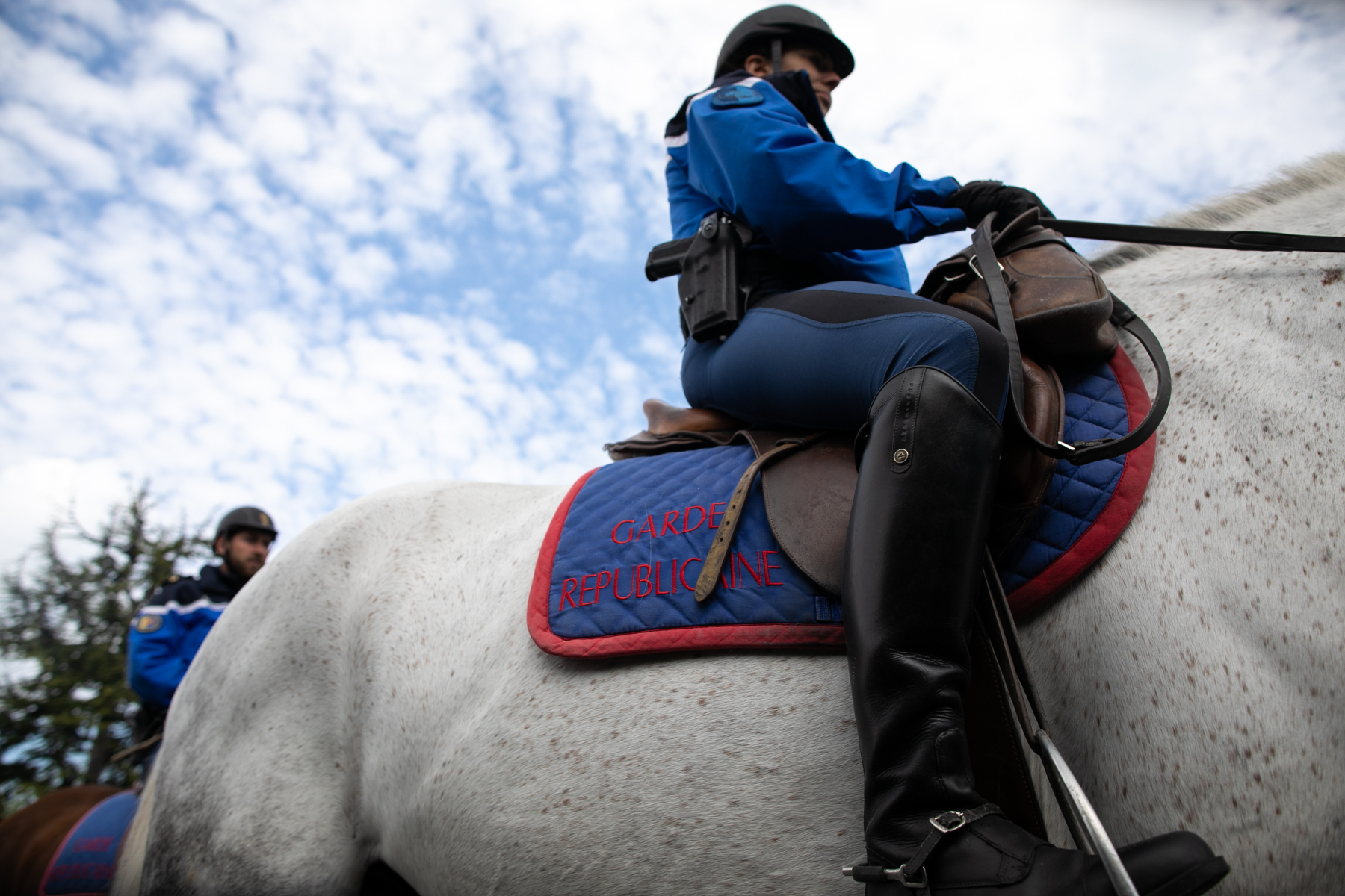 Garde républicaine mounted gendarme ride in the streets of Courseulles-sur-Mer, northwestern France, on April 17, 2020, following a strict lockdown across France to stop the spread of COVID-19, caused by the novel coronavirus.