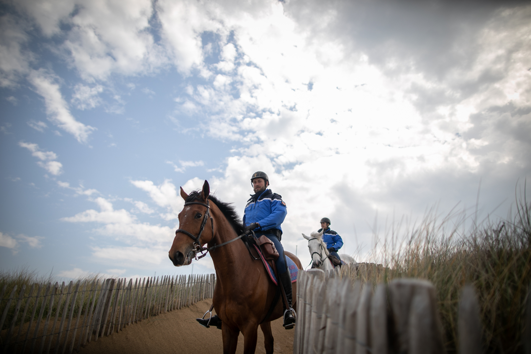 Garde républicaine mounted gendarmes arrives on the Courseulles-sur-Mer beach, northwestern France, on April 17, 2020, following a strict lockdown across France to stop the spread of COVID-19, caused by the novel coronavirus.67