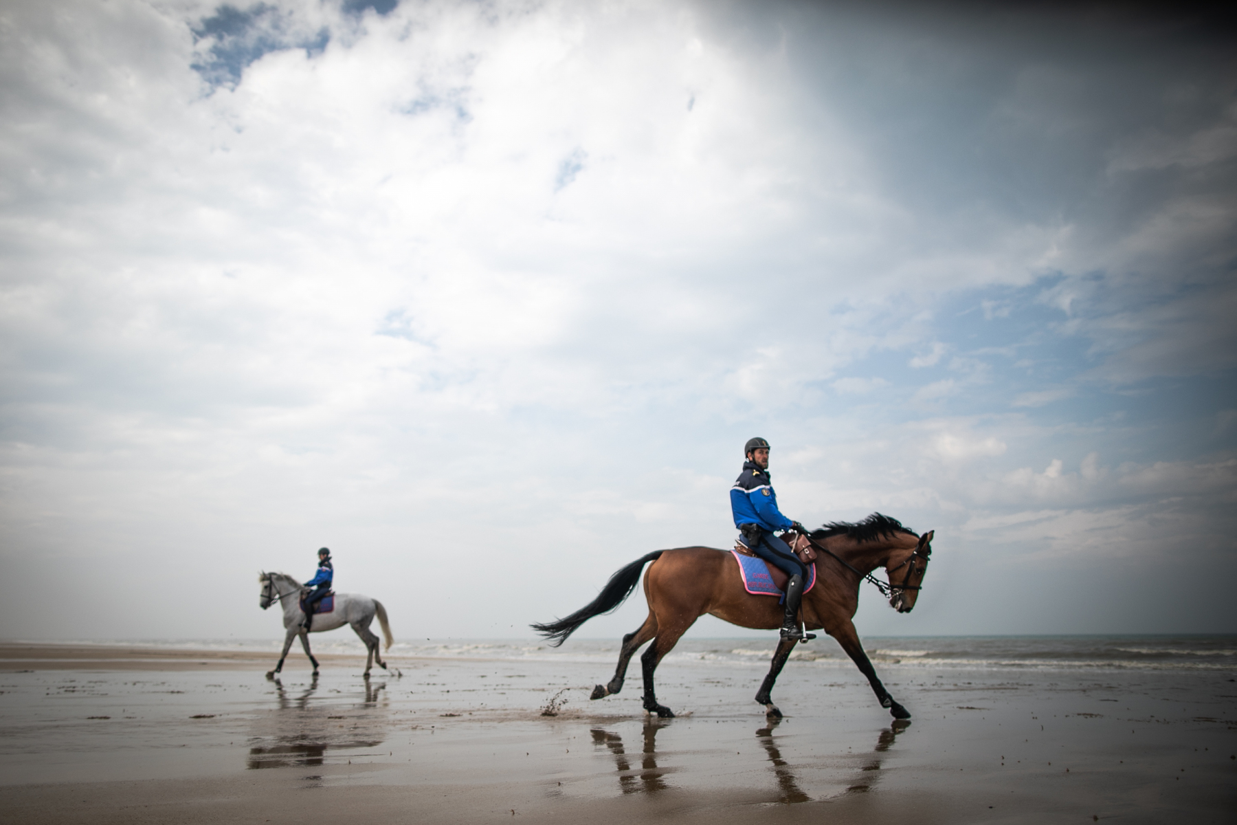 Garde républicaine mounted gendarmes ride on the Courseulles-sur-Mer beach, northwestern France, on April 17, 2020, following a strict lockdown across France to stop the spread of COVID-19, caused by the novel coronavirus.67