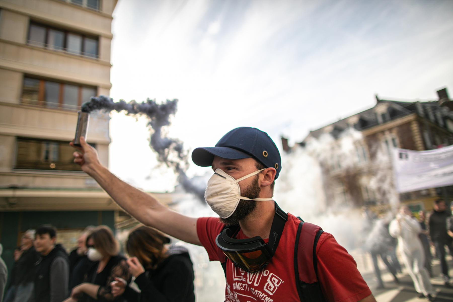 A militant holds a fumigene a demonstration on october 12, 2019, in Rouen, Normandy, to protest after the fire at the Lubrizol factory which occures on september 26, 2019.