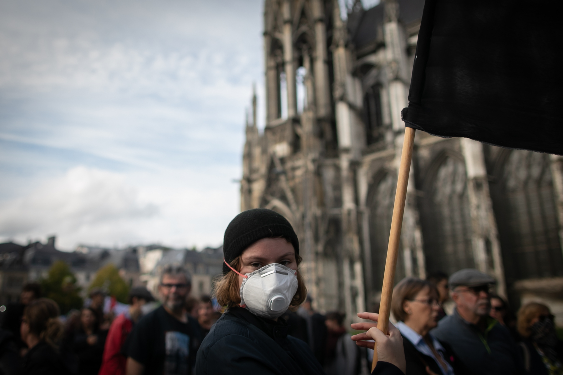 A militant holds a banner during a demonstration on october 12, 2019, in Rouen, Normandy, to protest after the fire at the Lubrizol factory which occures on september 26, 2019.